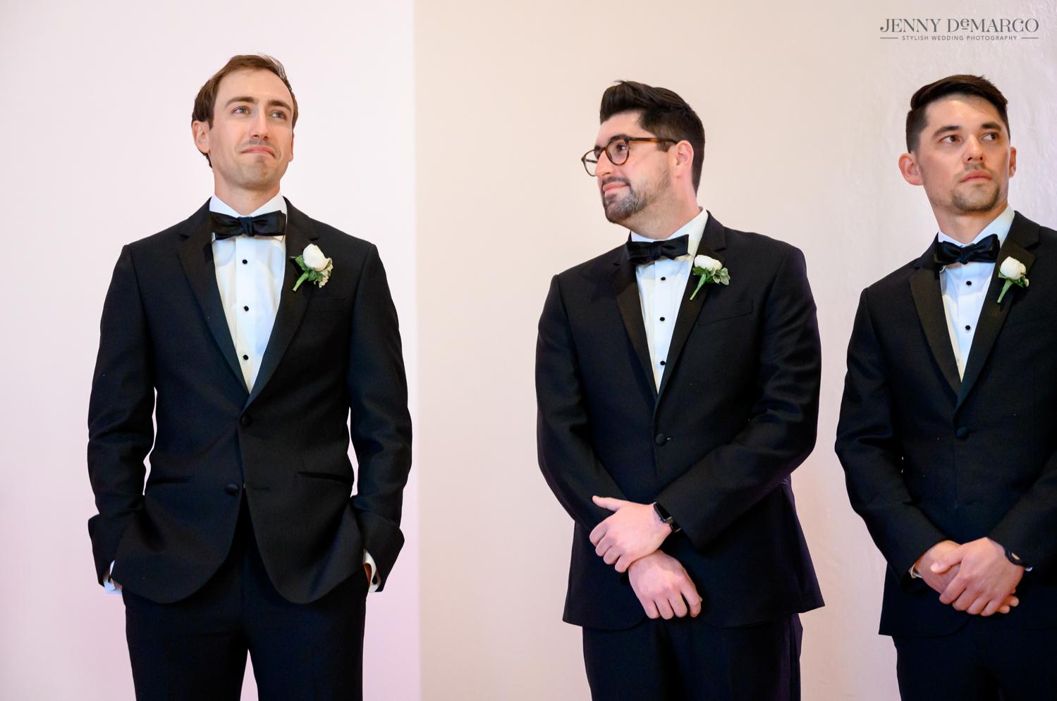 groom tearing up as he sees his bride walking down the aisle