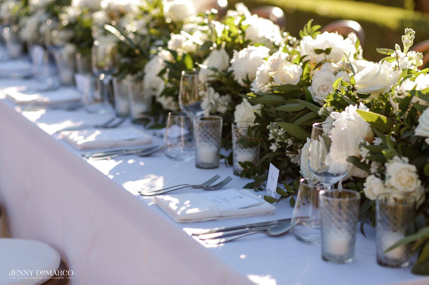 white floral table centerpieces and elegant table settings