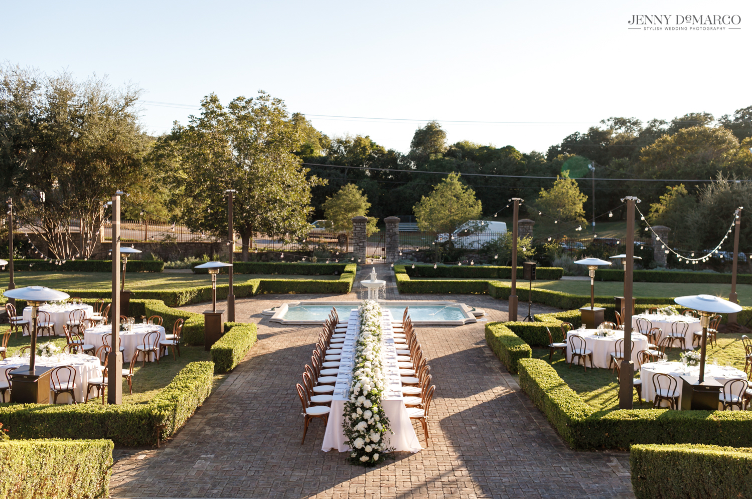 elegant dinner set up in the sunken garden at the Commodore Perry Hotel in Austin, Texas