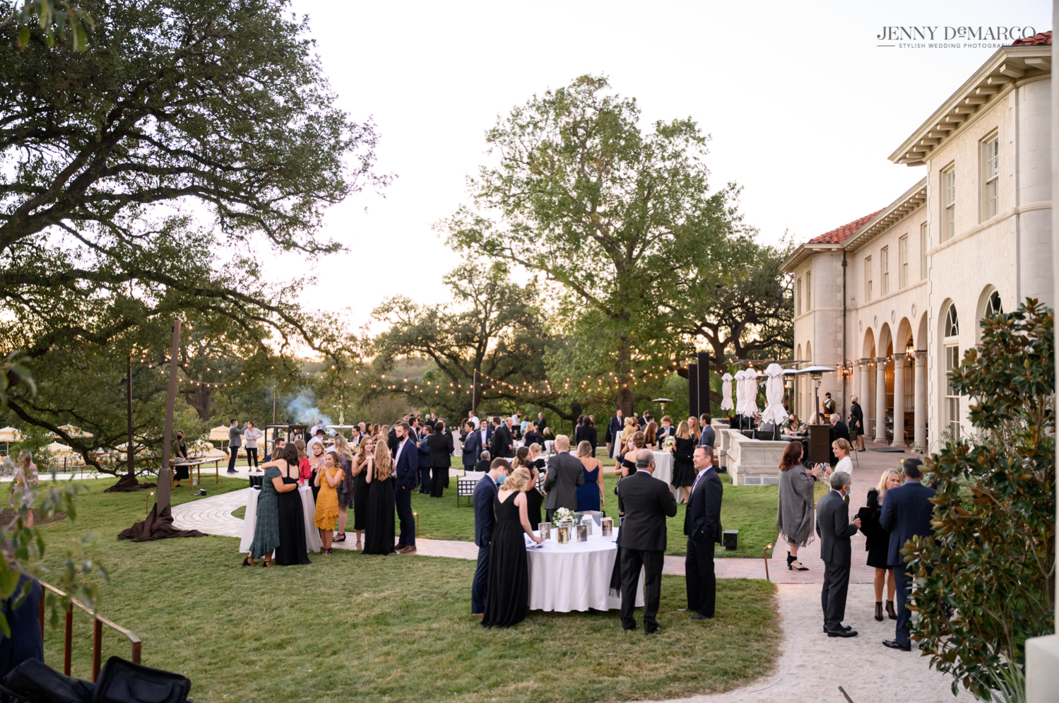 wedding guests enjoying the sunken garden at the Commodore Perry Hotel in Austin, Texas