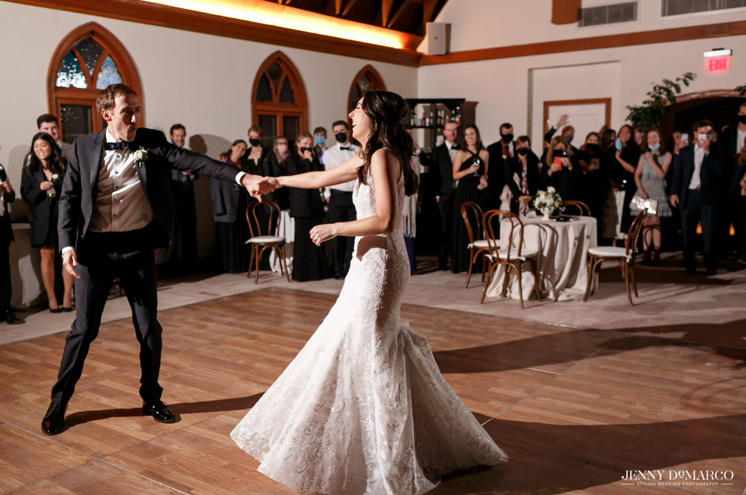 groom twirling his bride during their first dance