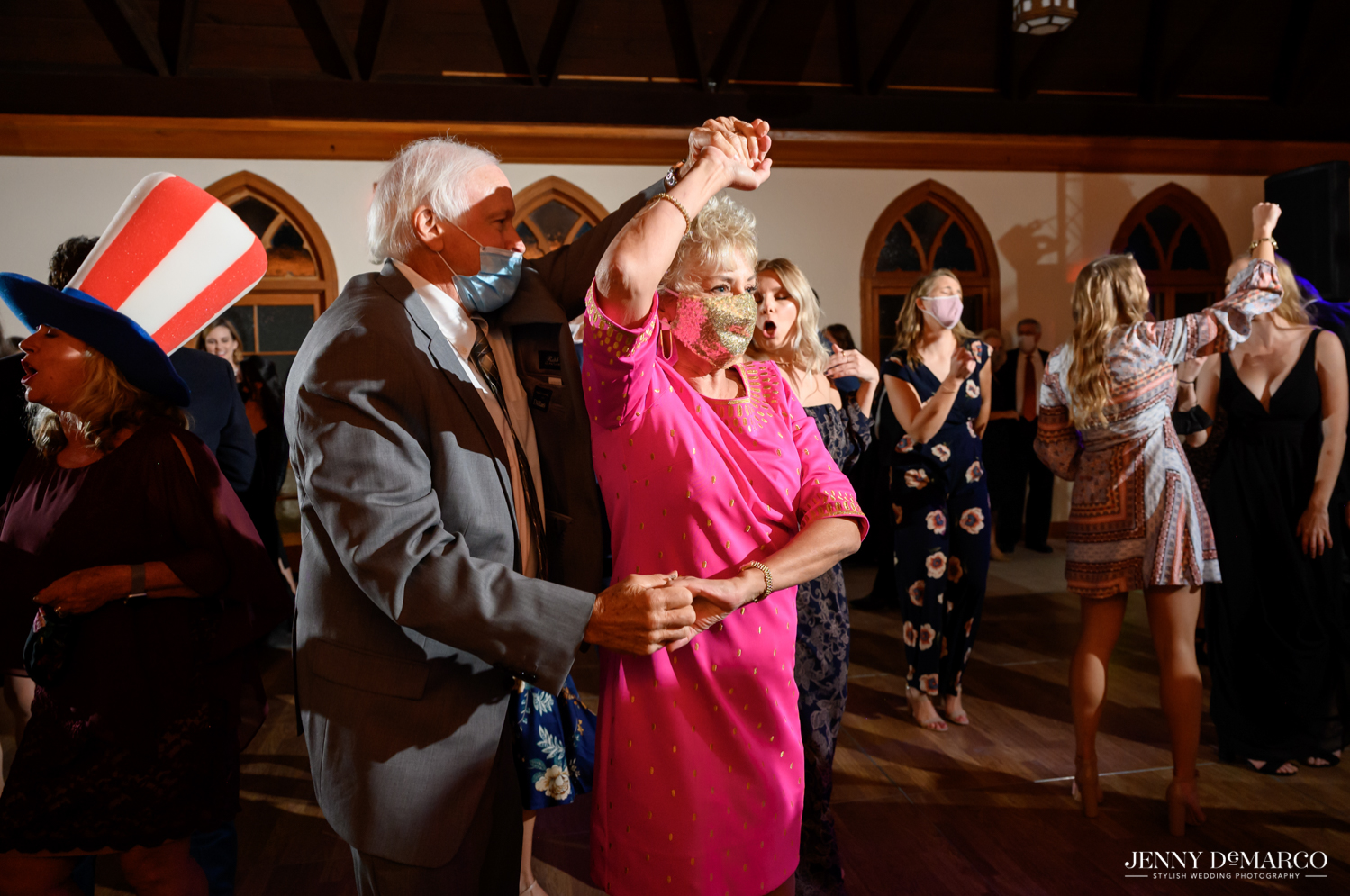 grandparents twirling and dancing at the wedding celebration