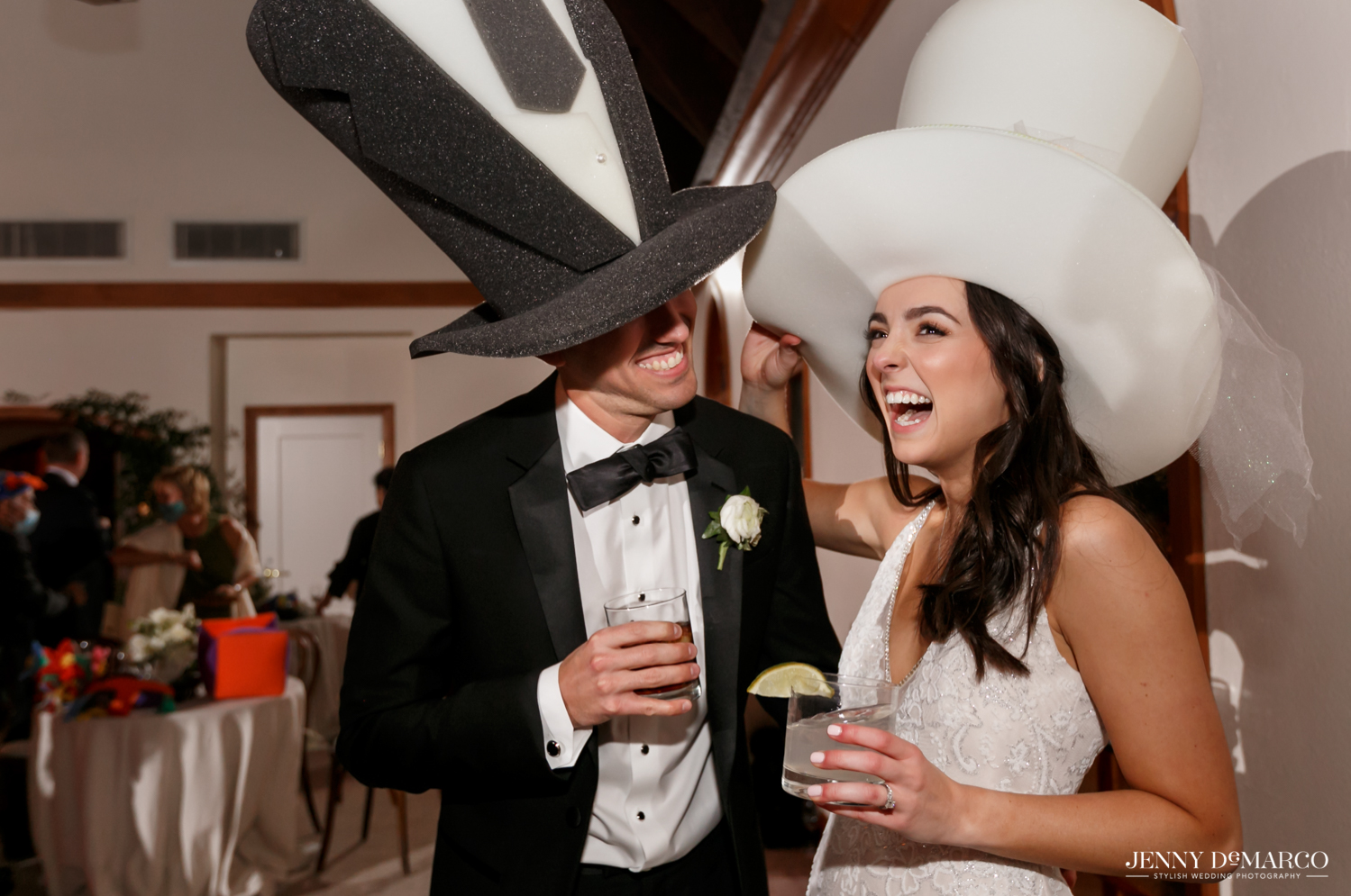 bride and groom laughing with their foam party hats on