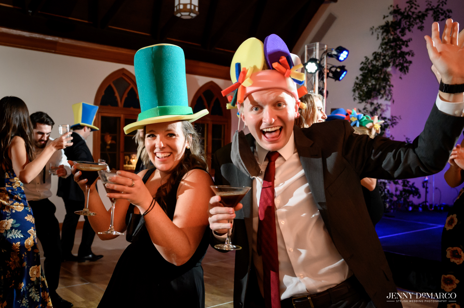 guests dancing and enjoying the wedding celebration with foam party hats on