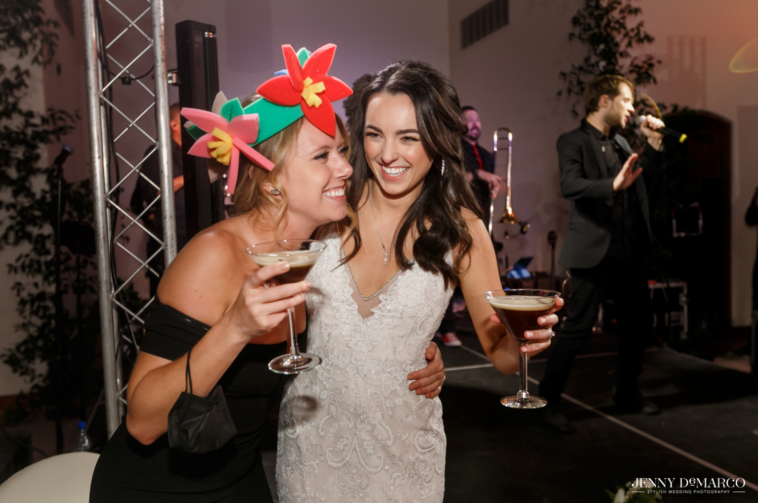 bride dancing with one of her bridesmaids enjoying the after party
