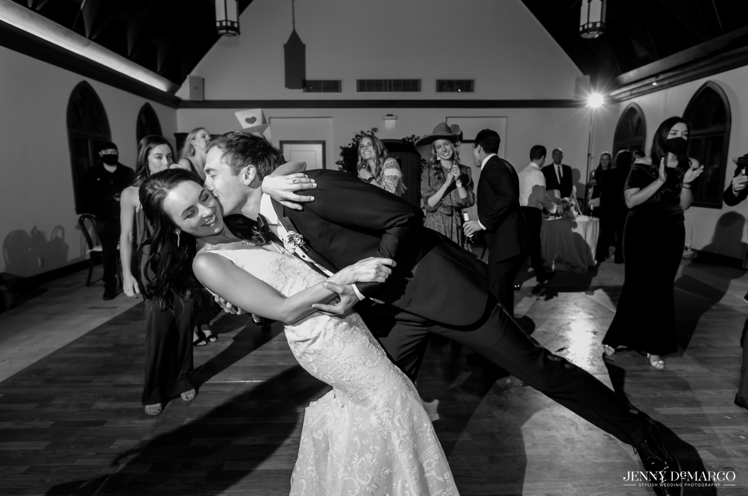 groom dipping his bride and kissing her on the cheek