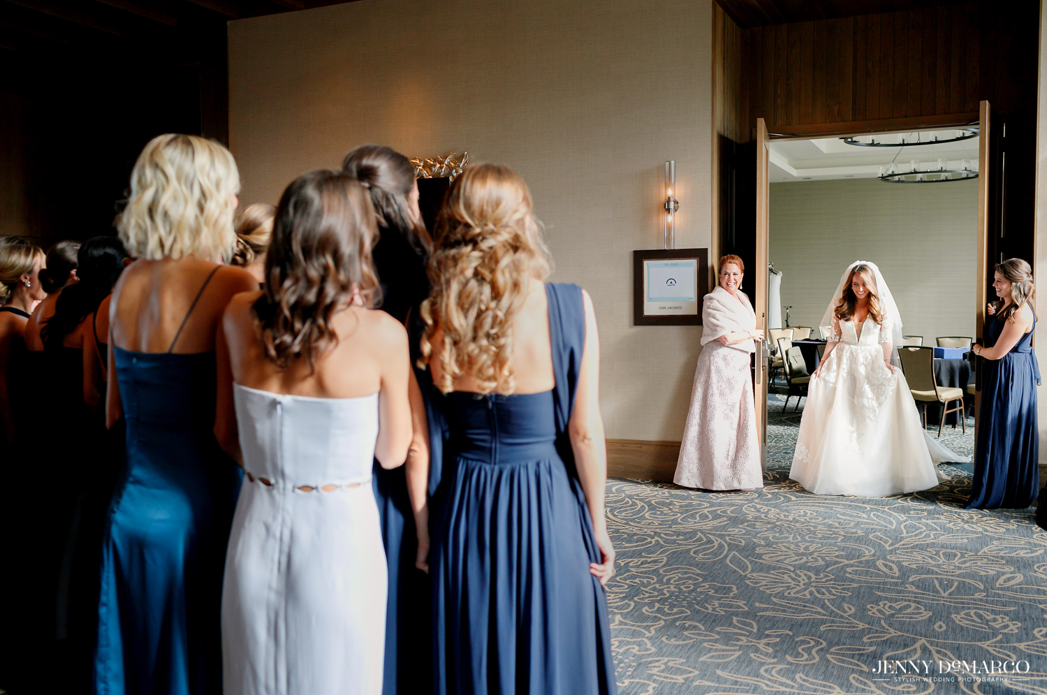 Bridesmaids see Brides big reveal in wedding dress