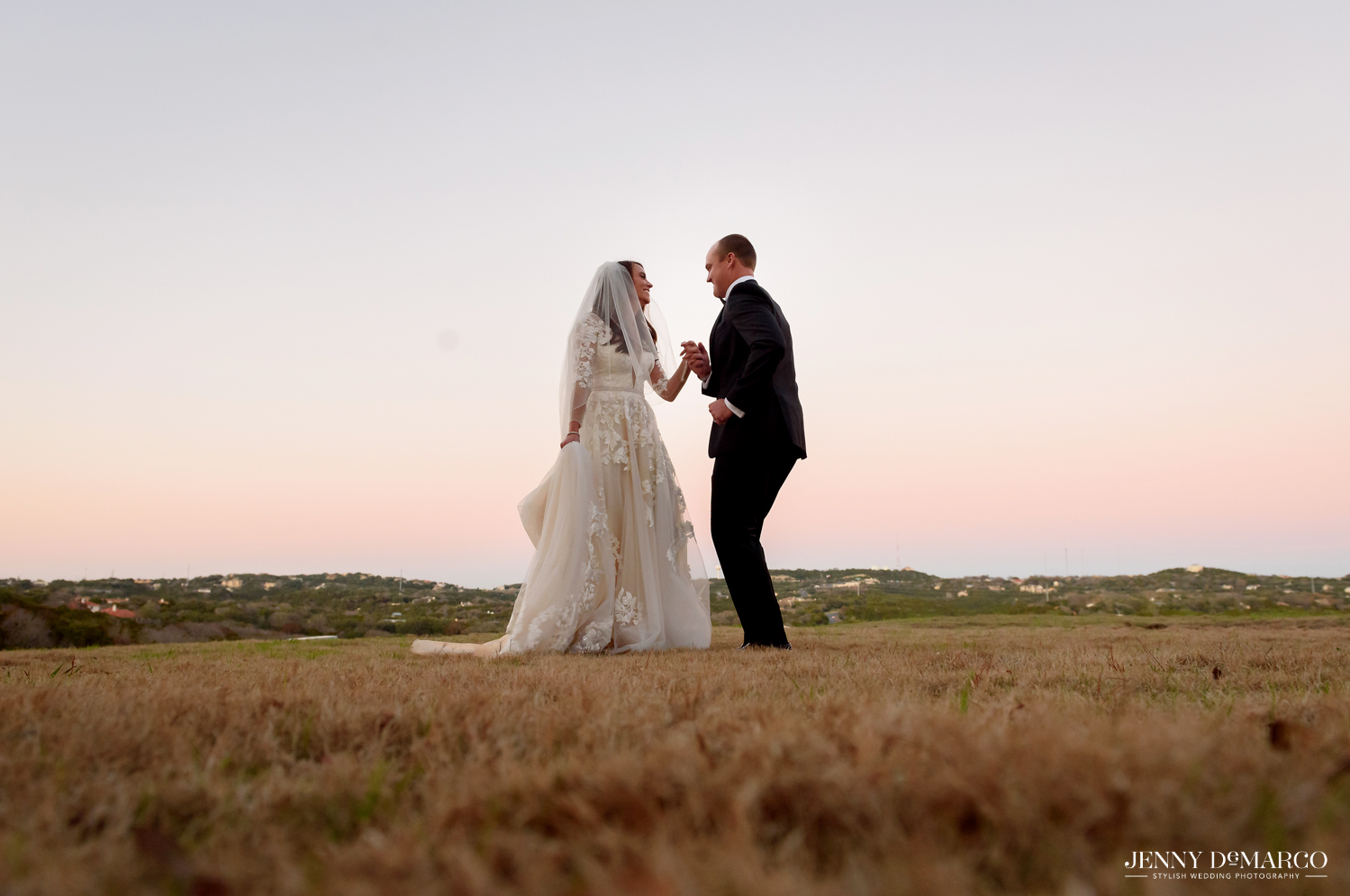 Bride and groom share a moment at sunset