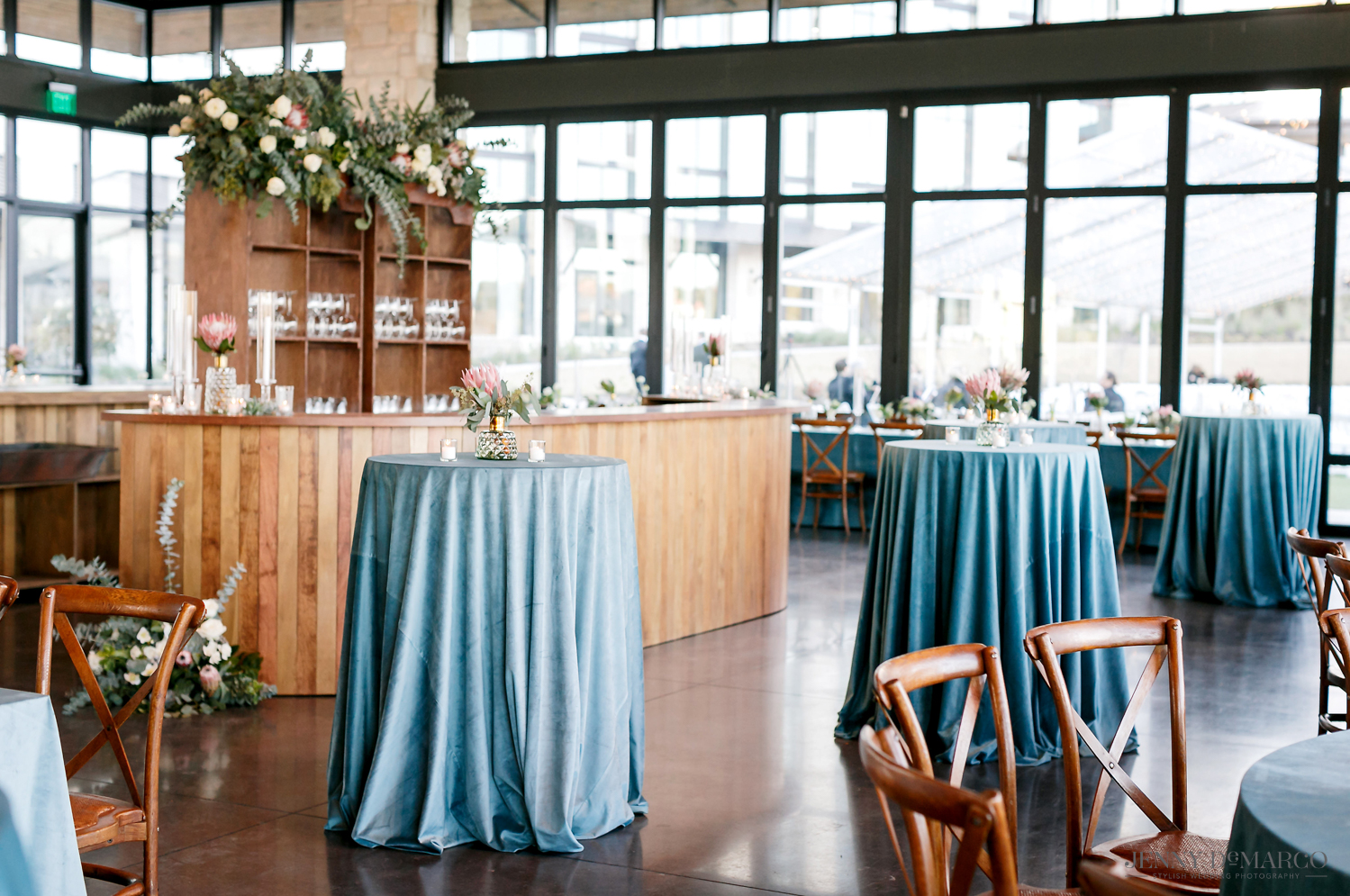 Blue table cloths at wedding reception