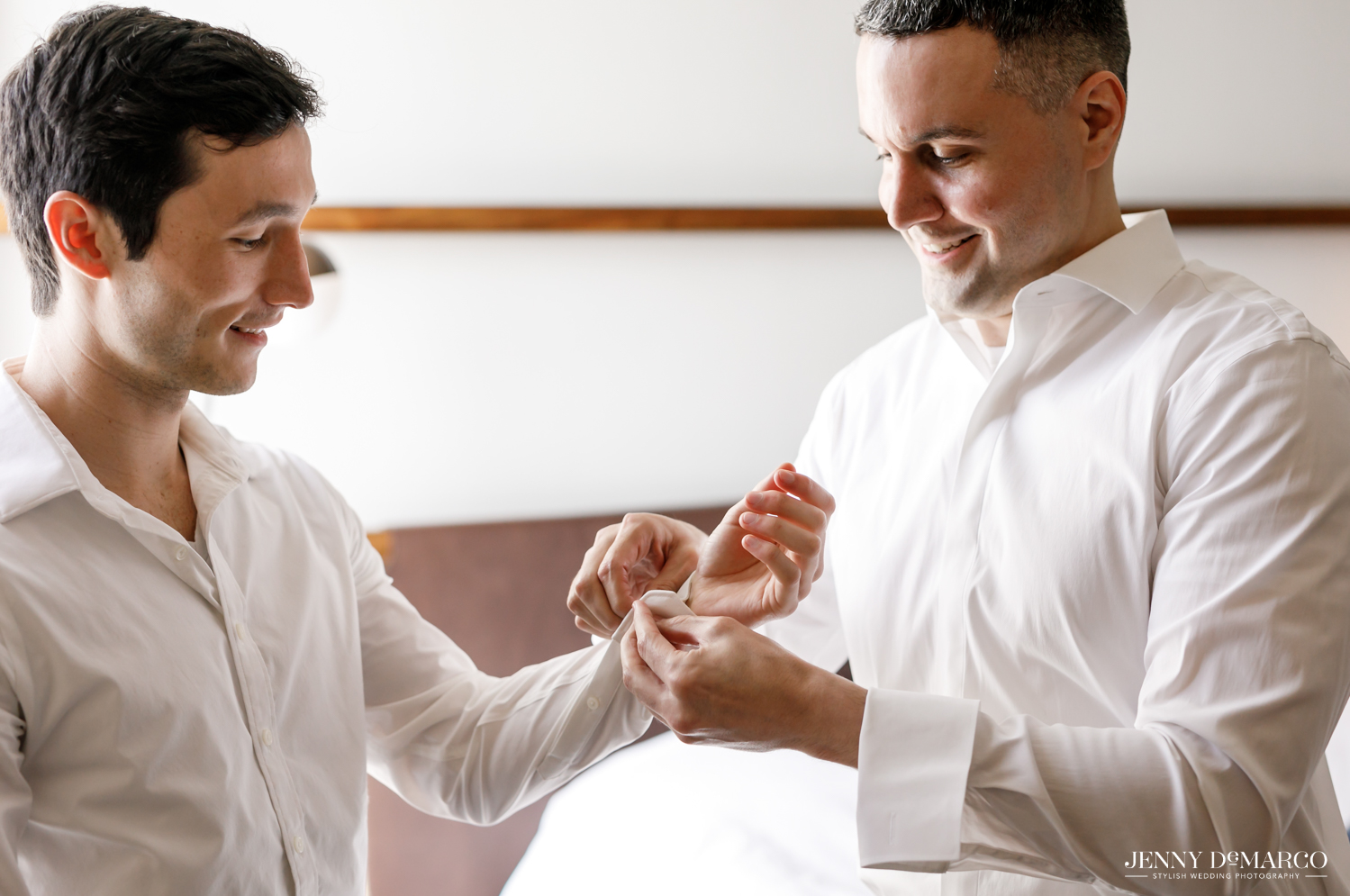 Grooms' helping each other get ready