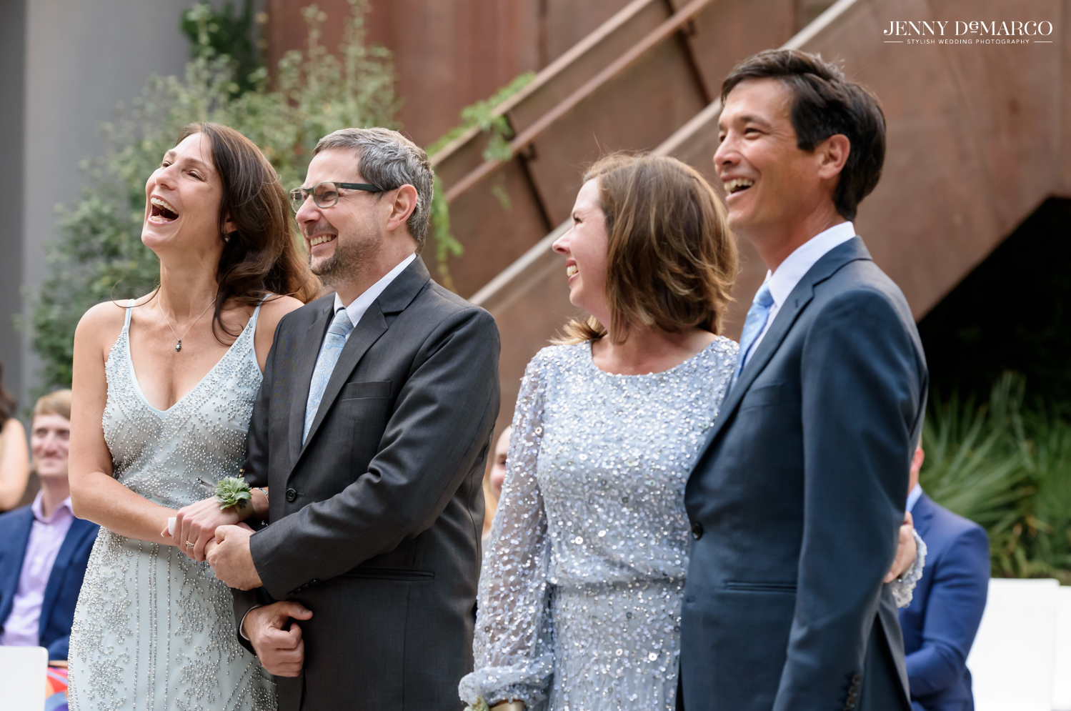 Parents of the groom laughing during the ceremony