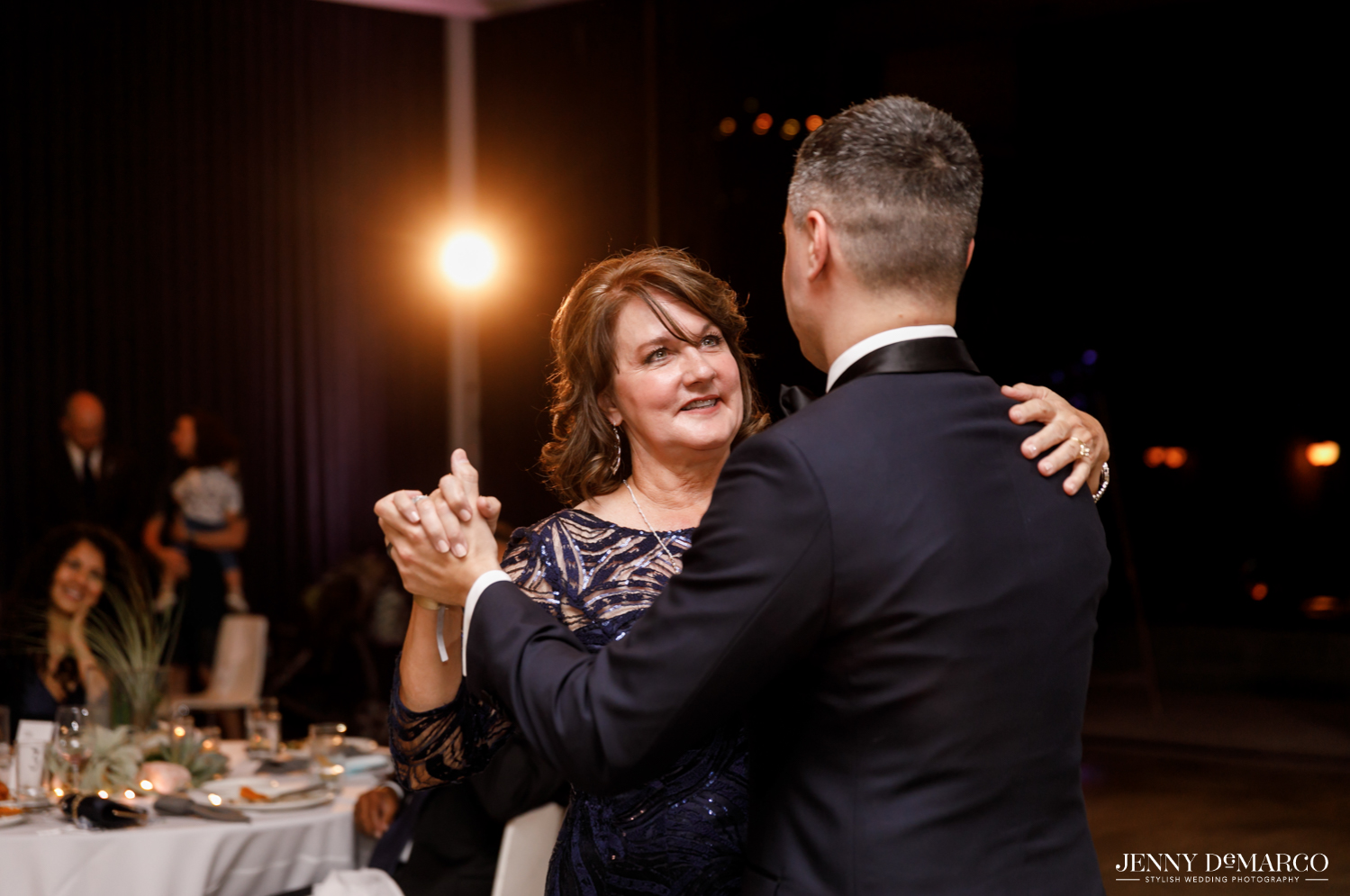Groom dancing with mother during reception