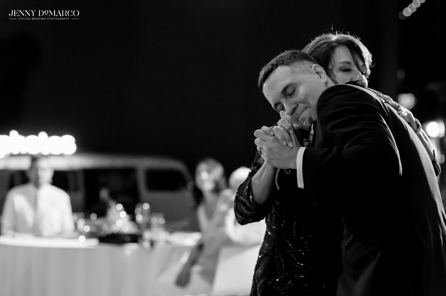 Groom embracing his mother while dancing