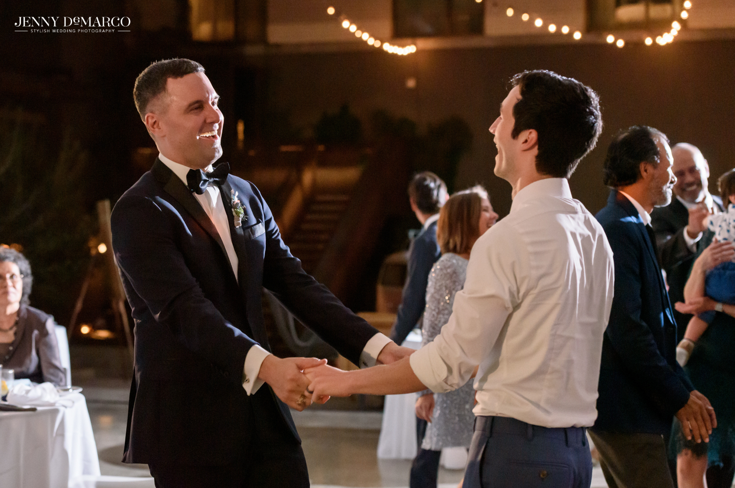 Grooms dancing during reception