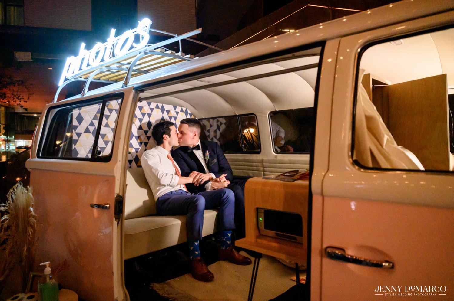 Grooms kissing in Volkswagen kick van photo booth