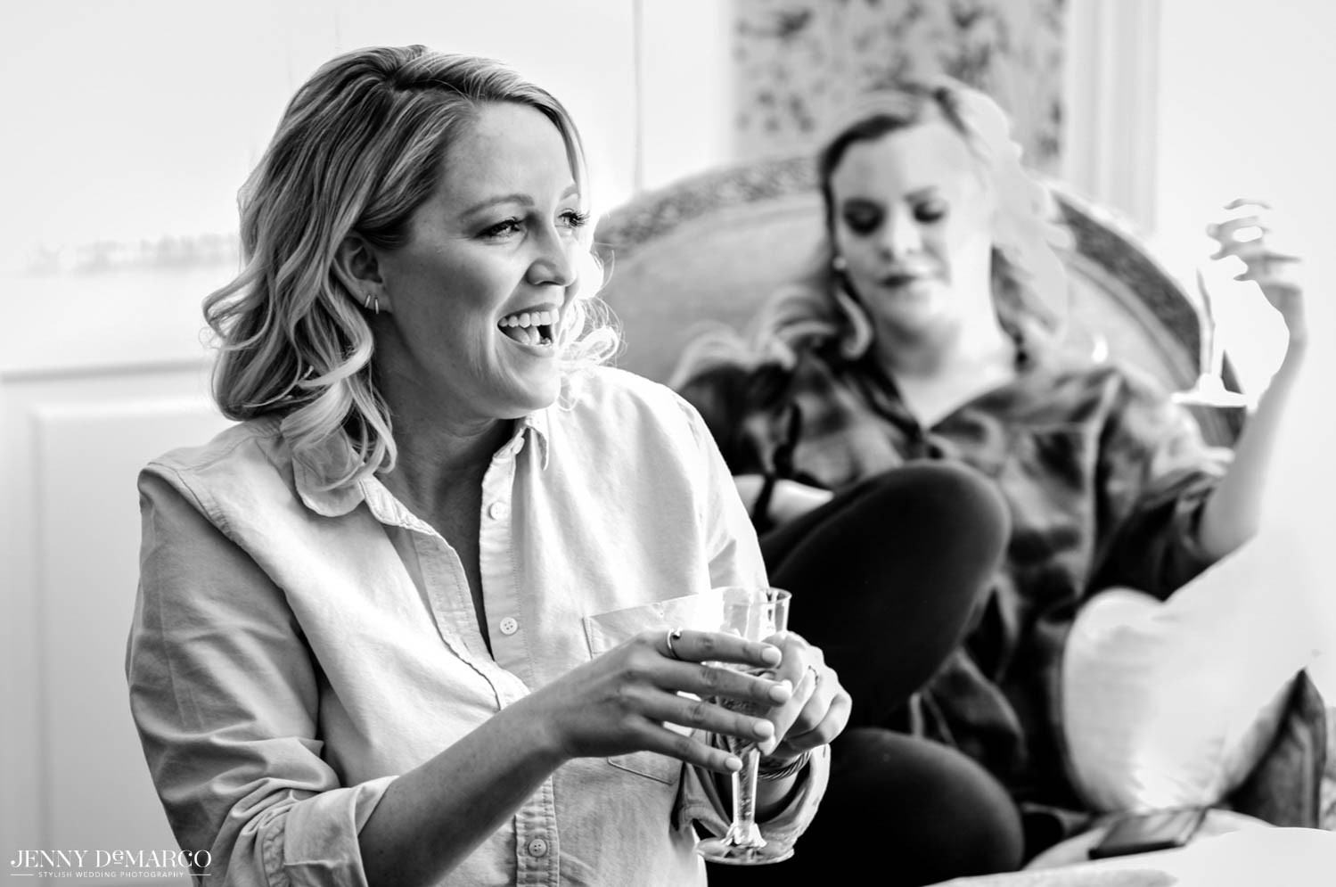 brides maid laughing and enjoying a drink