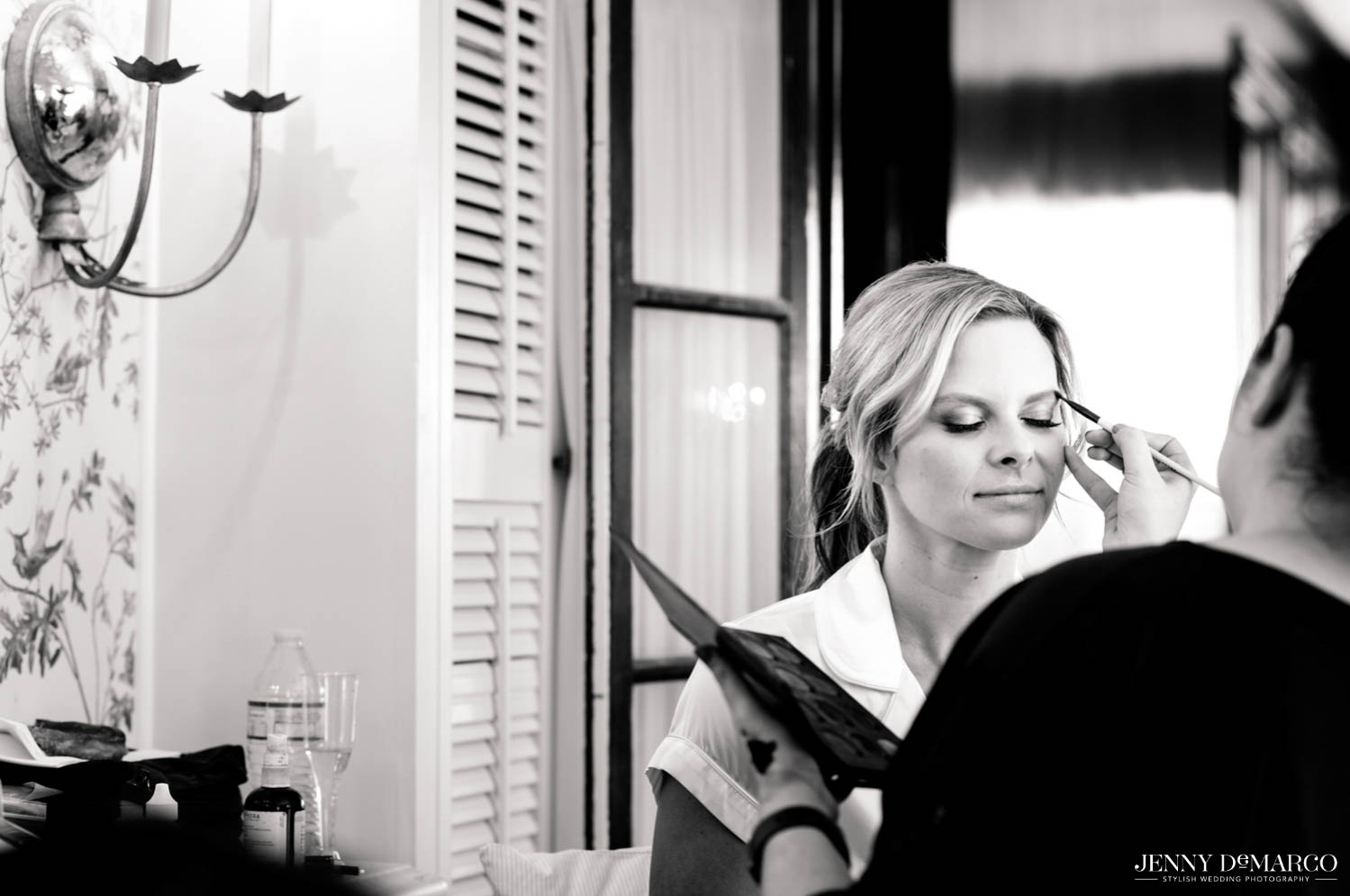 bride getting her make up done