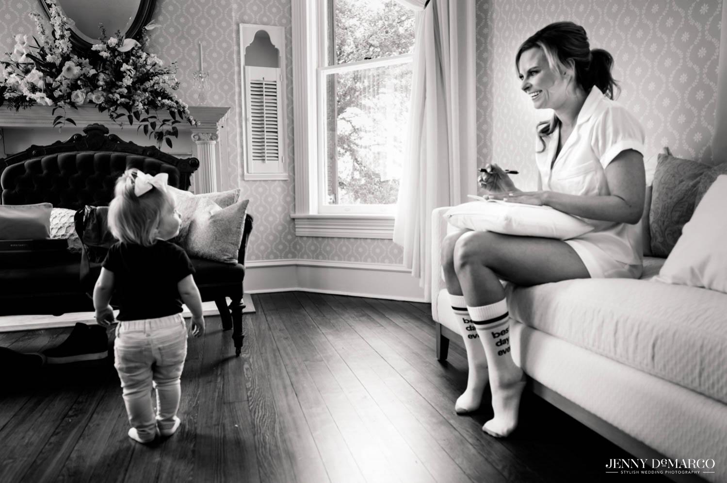 bride smiling at little girl