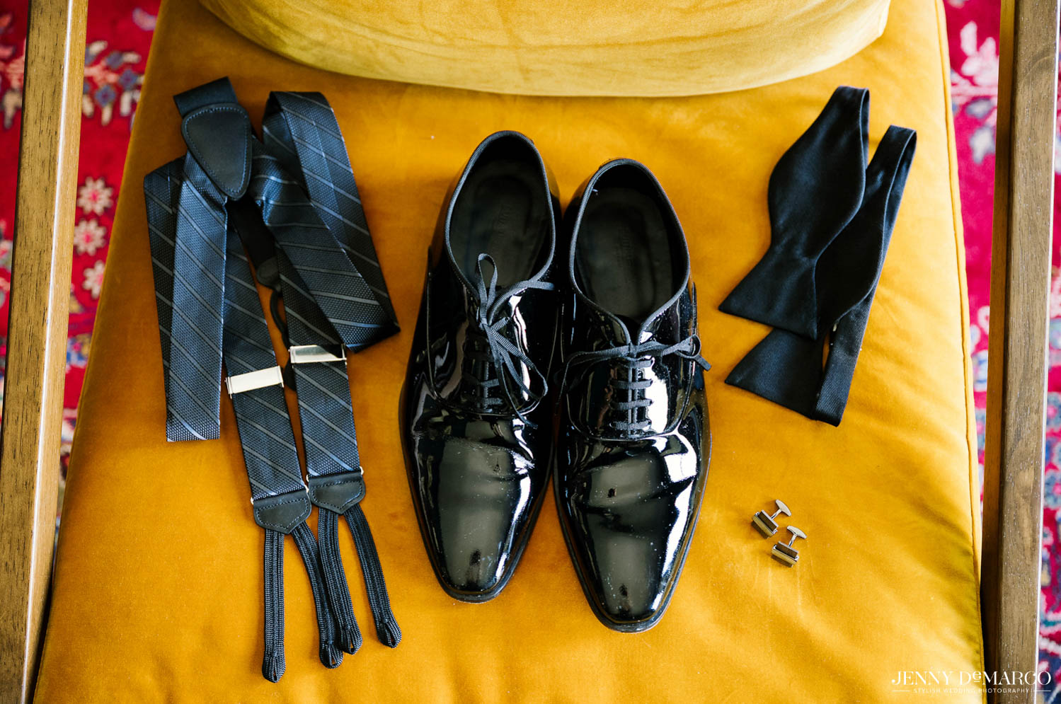 groom accessories of suspenders, shoes, and bow tie