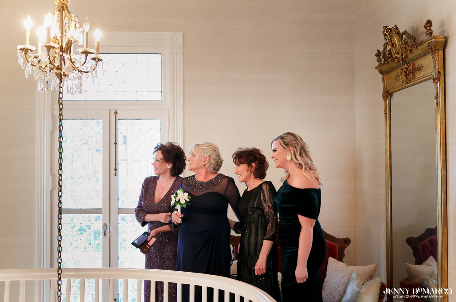 bride family smiling as they see the bride for the first time