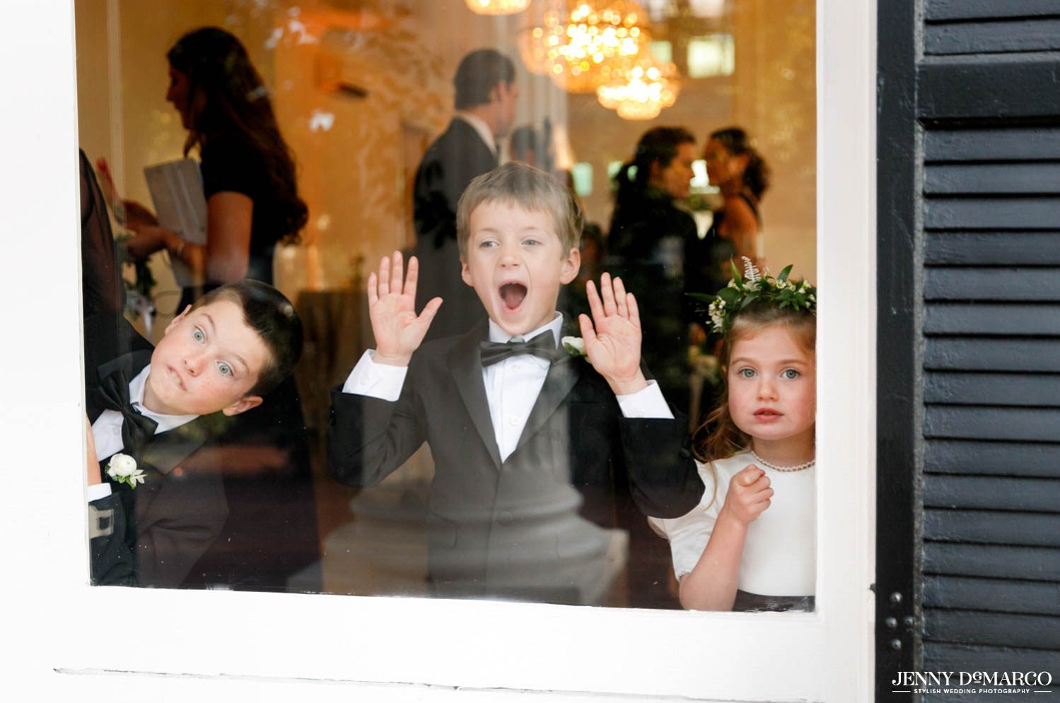 young children in ceremony making silly faces out the window