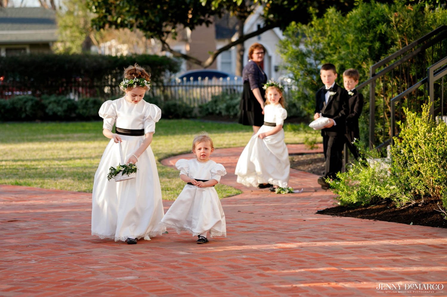 flower girls walking into the ceremony and dropping greenery