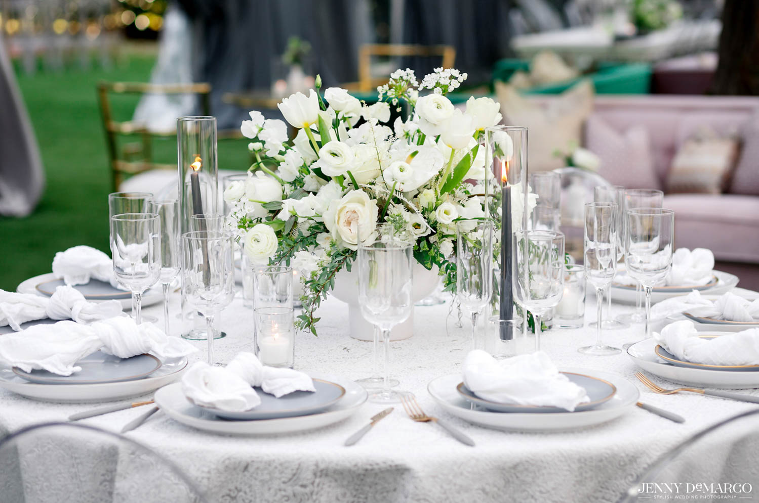 set dinner table with white floral in center