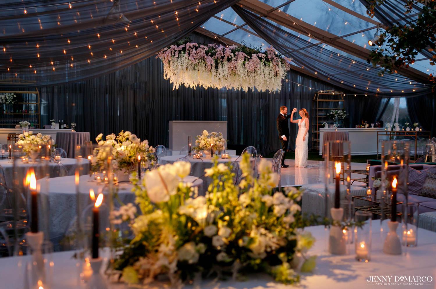 bride and groom dancing in center of dance floor
