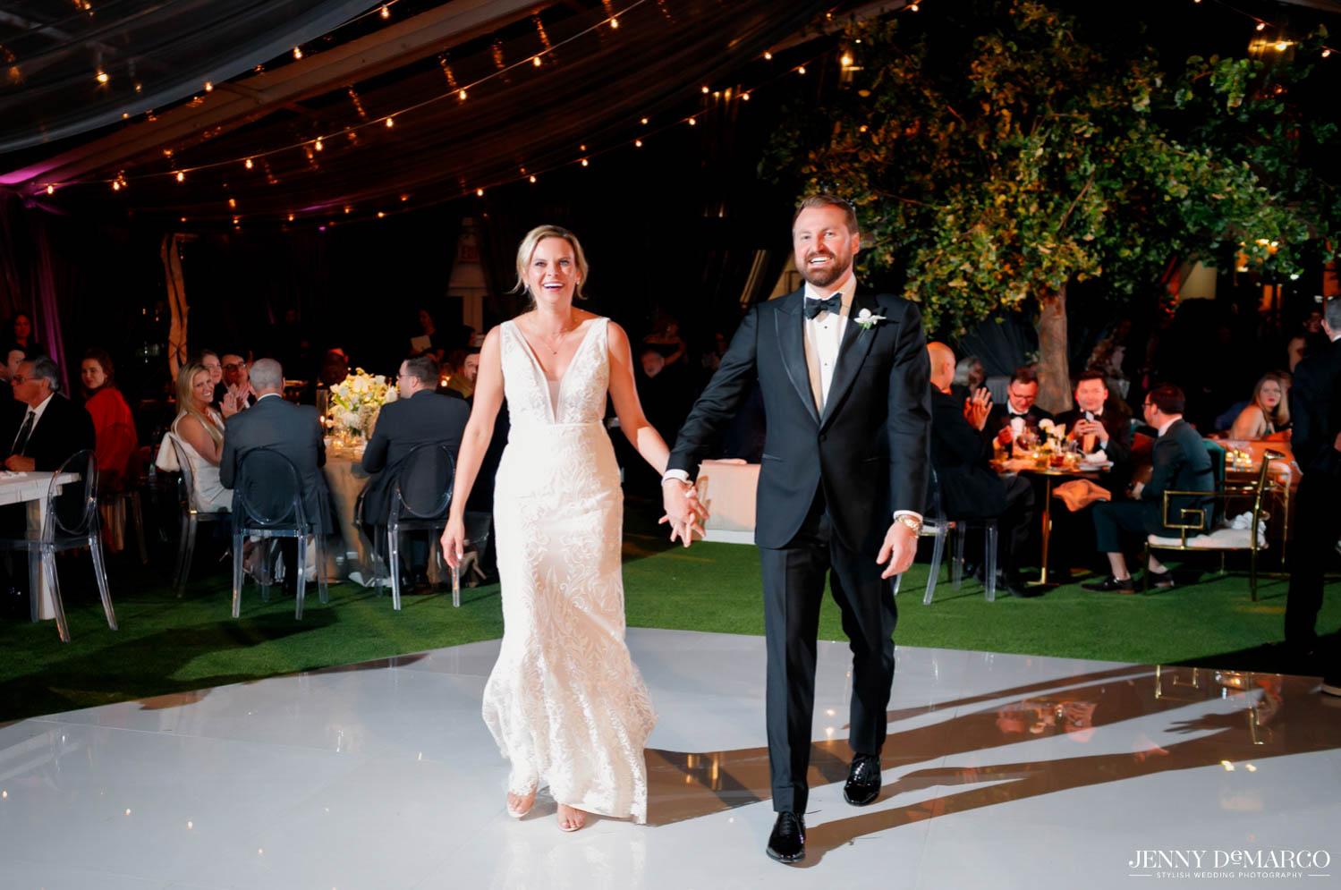 bride and groom entering into reception