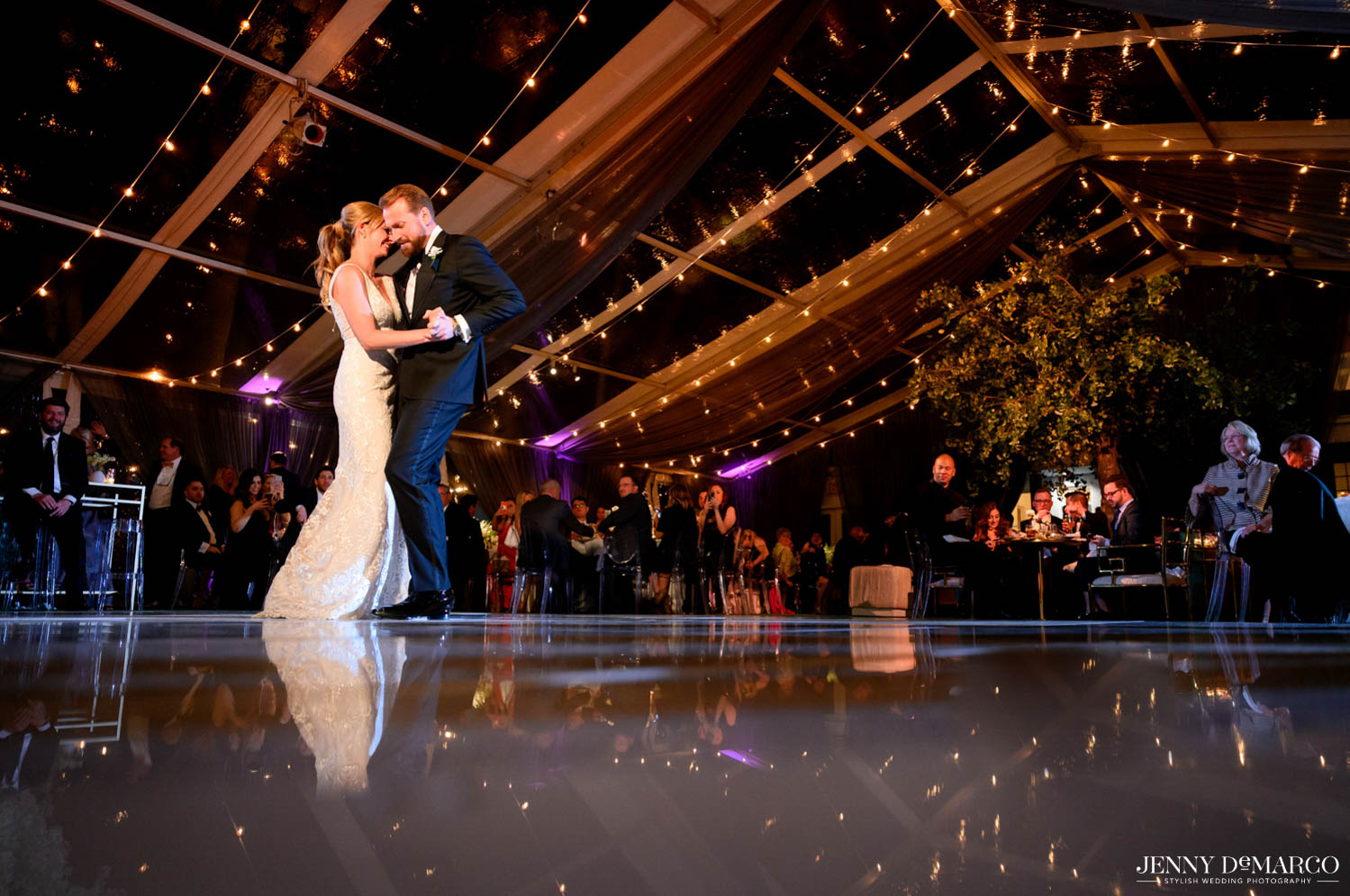 bride and grooms first dance under twinkle lights