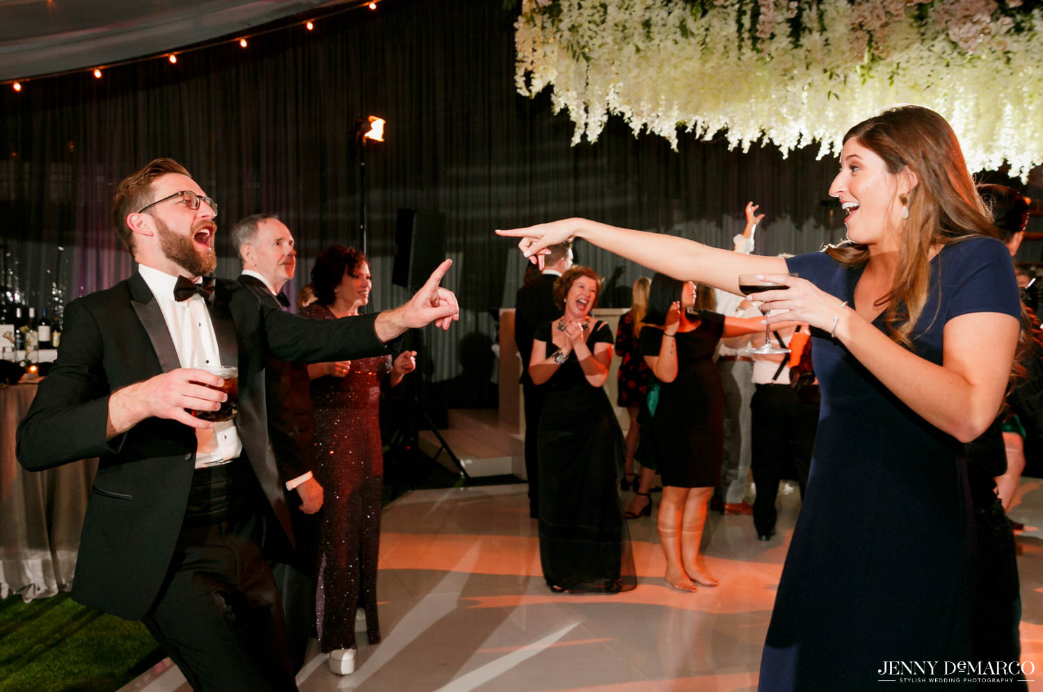 guests dancing and pointing at each other smiling