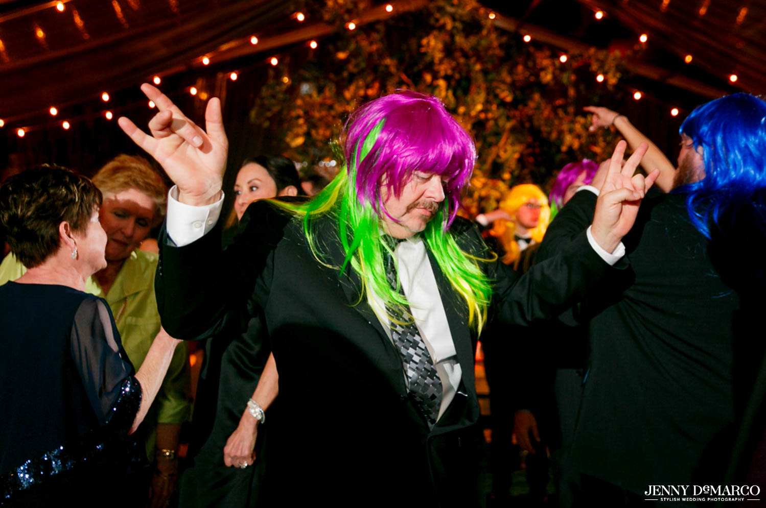 guests with bright pink and green neon wig dancing