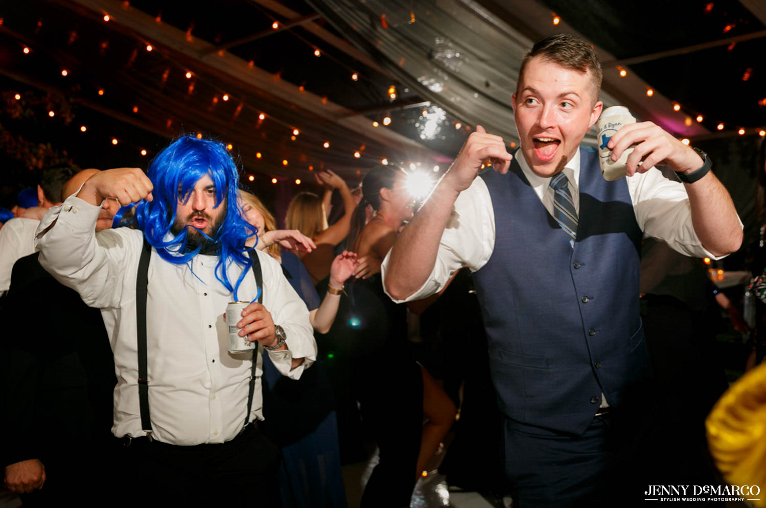 groomsmen dancing with bright blue wigs