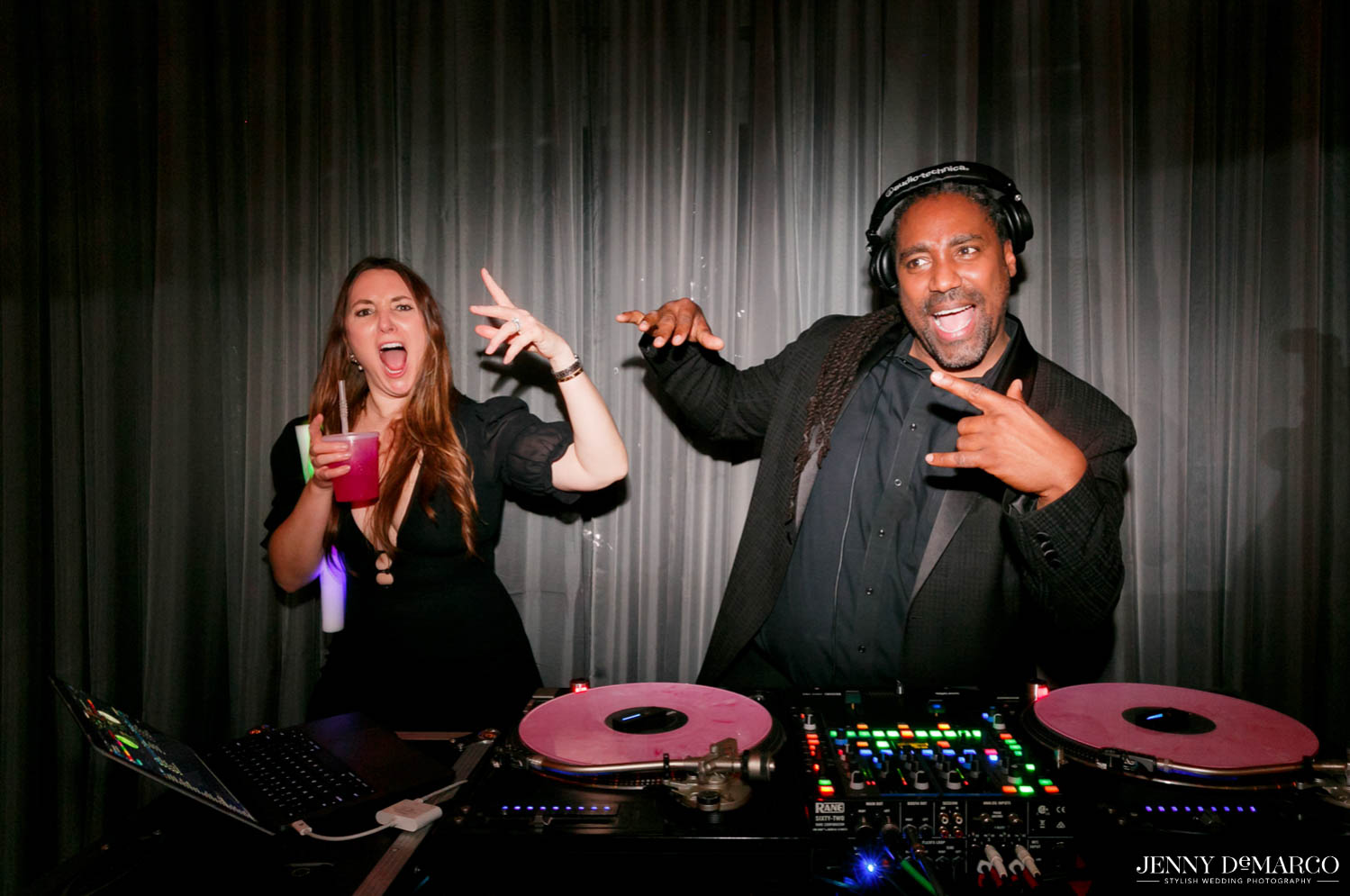 guest dancing with DJ behind DJ booth