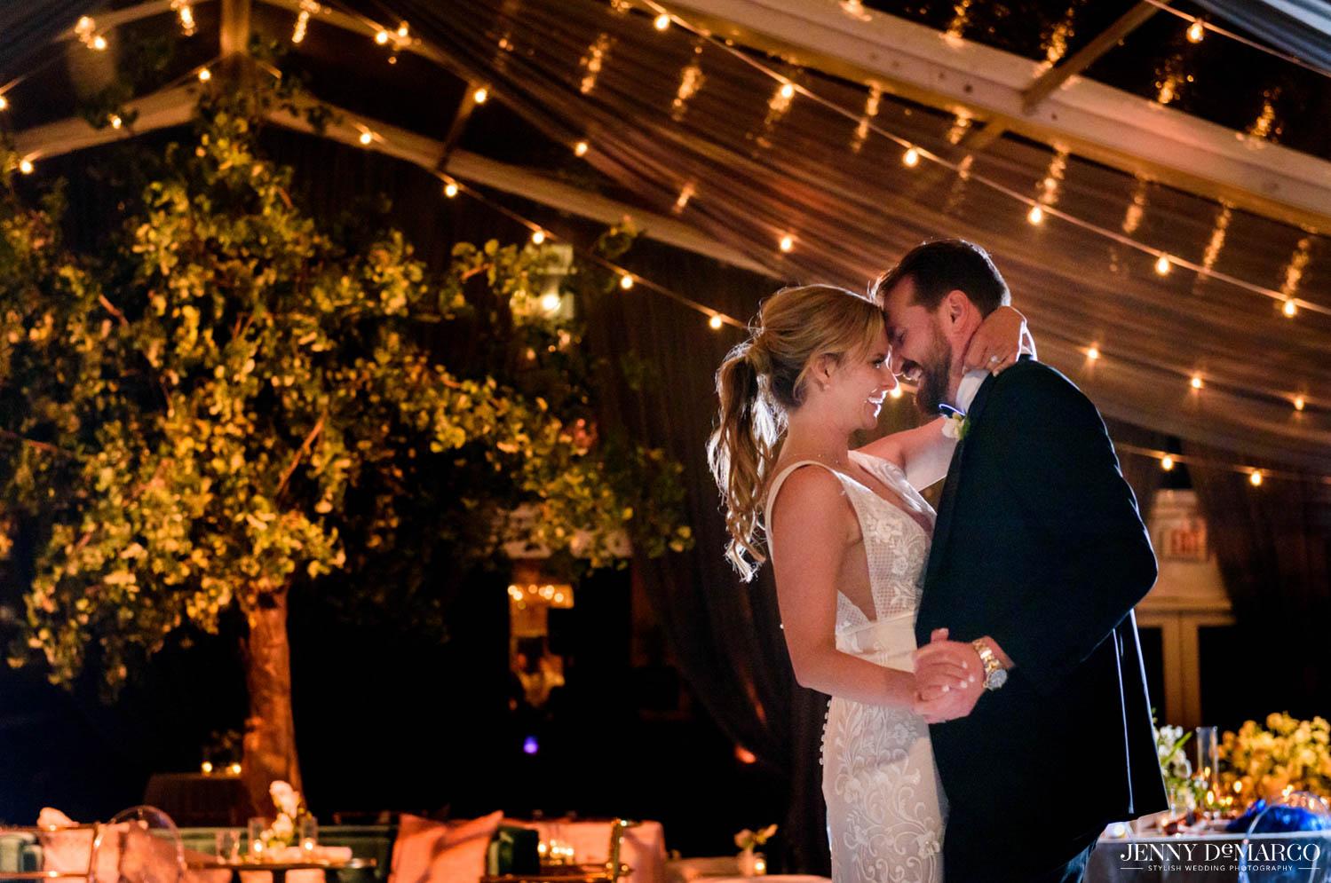 bride and groom dancing alone on dance floor
